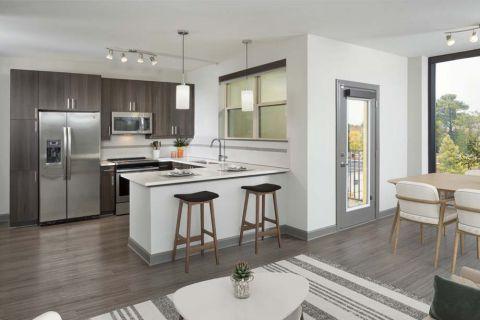Living Room and Kitchen at Camden Buckhead Square Apartments in Atlanta, GA