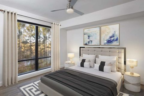 White contemporary bedroom with floor-to-ceiling windows  at Camden Buckhead apartments in Atlanta, GA