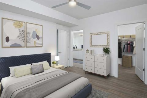 White contemporary bedroom with walk-in closet at Camden Buckhead apartments in Atlanta, GA