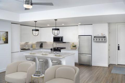 White Contemporary Kitchen and Living Room at Camden Buckhead apartments in Atlanta, GA