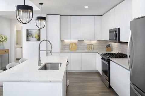 White Contemporary Kitchen at Camden Buckhead apartments in Atlanta, GA