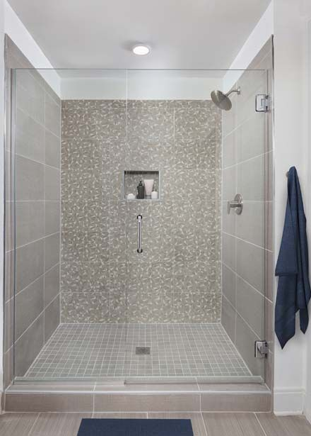 Glass enclosed standing shower with geometric tile surround at Camden Buckhead apartments in Atlanta, GA