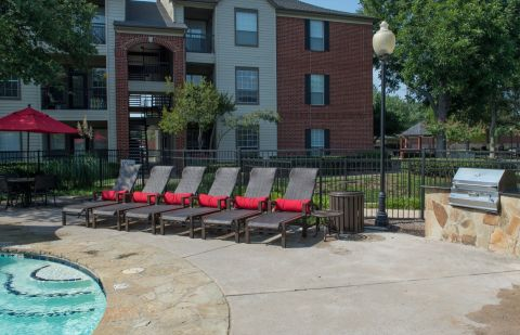 Pool with Sundeck at Camden Buckingham Apartments in Richardson, TX