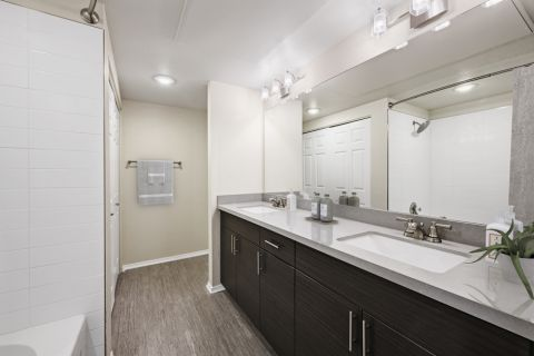 Bathroom with Dual Vanity Sinks at Camden Caley Apartments in Englewood, CO
