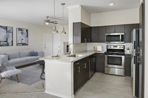 Kitchen with Stainless Steel Appliances at Camden Caley Apartments in Englewood, CO