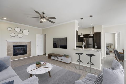 Living Room with Fireplace at Camden Caley Apartments in Englewood, CO