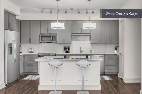 Kitchen with grey design scope and stainless steel appliances at Camden Carolinian in Raleigh North Carolina