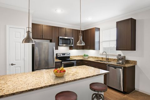 Kitchen with Venetian Gold Countertops at Camden Cedar Hills Apartments in Austin, TX