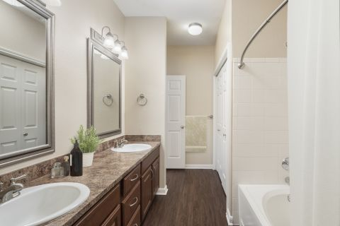 Bathroom with double sinks at Camden Centreport Apartments in Ft. Worth, Texas
