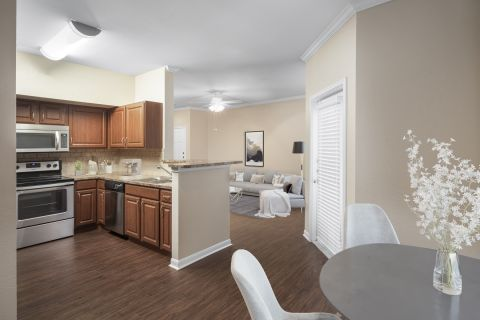 Kitchen and dining area at Camden Centreport Apartments in Ft. Worth, TX
