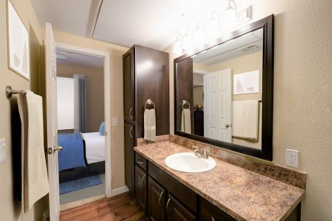 Bathroom with dark cabinets at Camden Centreport Apartments in Ft. Worth, TX
