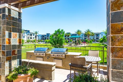 BBQ Grills and Playground at Camden Chandler Apartments in Chandler, AZ