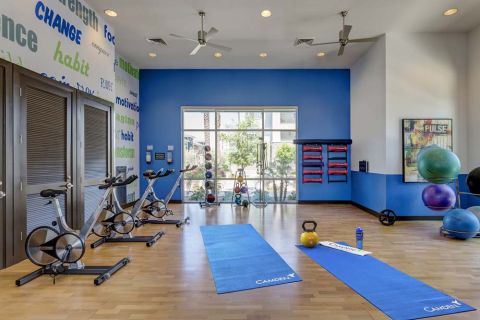 Fitness Center with Spin Bikes, Yoga and Virtual Trainer at Camden Chandler Apartments in Chandler, AZ