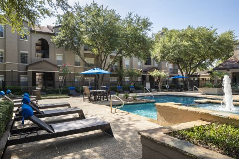 Pool with Seating at Camden Cimarron Apartments in Irving, TX