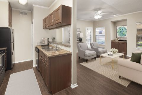 Kitchen and Living Room with Wood-Style Floors at Camden Cimarron Apartments in Irving, TX