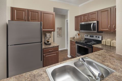 Spacious Kitchen at Camden Cimarron Apartments in Irving, TX