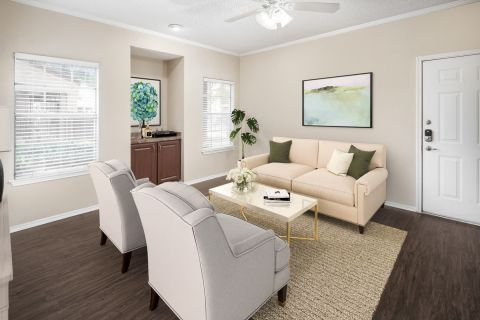 Living Room with Wood-Style Floors at Camden Cimarron Apartments in Irving, TX