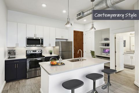 Contemporary Style Kitchen with Quartz Countertops and Herringbone Backsplash at Camden City Centre Apartments in Houston, TX