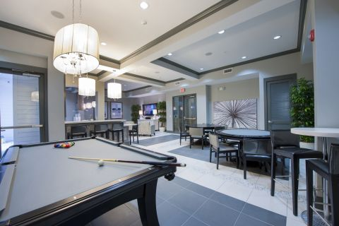 Resident Lounge with Poker Table and Kitchen at Camden City Centre Apartments in Houston, TX