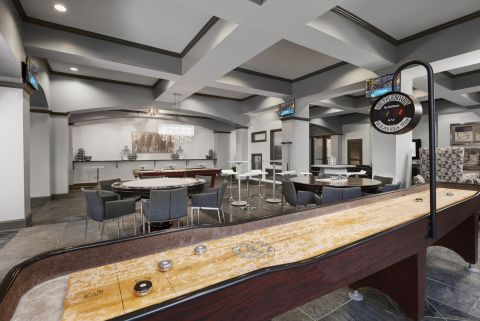 Game Lounge with Shuffleboard at Camden City Centre Apartments in Houston, TX