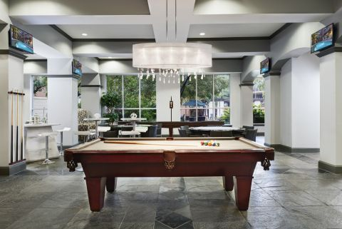 Game Lounge with Billiards and Shuffleboard at Camden City Centre Apartments in Houston, TX