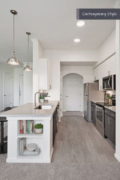 Contemporary Style Kitchen with stainless steel appliances at Camden City Centre Apartments in Houston, TX