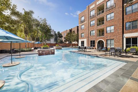 Pool with Tanning Shelf at Camden City Centre Apartments in Houston, TX