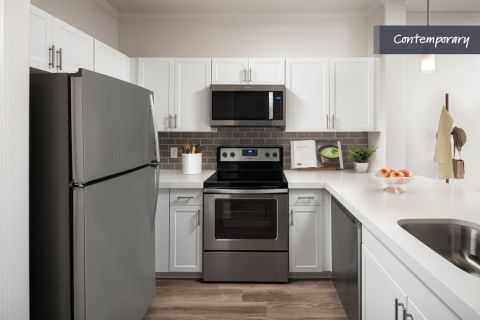 Kitchen with White Quartz Countertop and Stainless Steel Appliances at Camden Copper Square Apartments in Phoenix, AZ