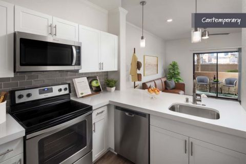 Open Concept Kitchen with White Quartz Countertop and Stainless Steel Appliances at Camden Copper Square Apartments in Phoenix, AZ