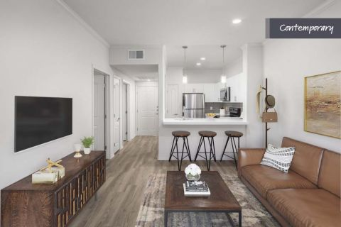 Open Concept Living Room and Kitchen with Wood-Style Flooring at Camden Copper Square Apartments in Phoenix, AZ