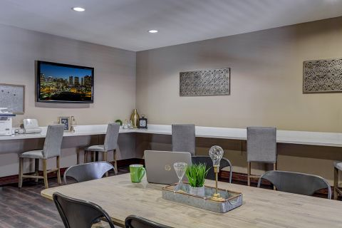 Community workspace with printer at Camden Copper Square Apartments in Phoenix, AZ