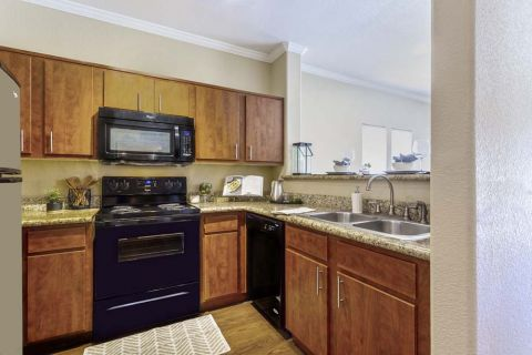 Kitchen with Granite Countertops at Camden Copper Square Apartments in Phoenix, AZ