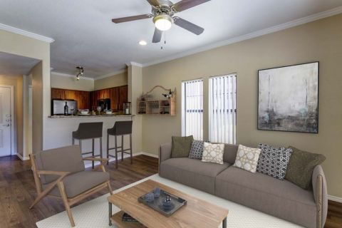 Living Room and Dining Area at Camden Copper Square Apartments in Phoenix, AZ