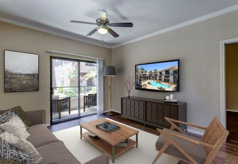 Living Room with Patio at Camden Copper Square Apartments in Phoenix, AZ