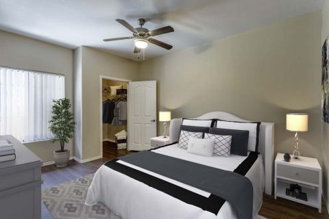 Bedroom with Walk-In Closet at Camden Copper Square Apartments in Phoenix, AZ