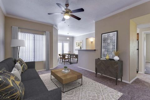 Living Room with View of Dining Area at Camden Copper Square Apartments in Phoenix, AZ