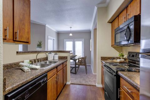 Kitchen with Dining Area at Camden Copper Square Apartments in Phoenix, AZ