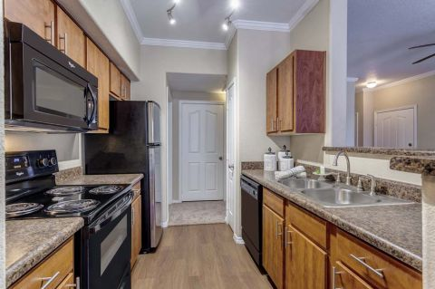 Kitchen with Laminate Countertops at Camden Copper Square Apartments in Phoenix, AZ