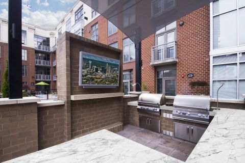 Outdoor Kitchen at Camden Cotton Mills Apartments in Charlotte, NC