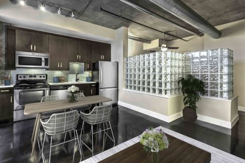 Kitchen in Studio Floor Plan at Camden Cotton Mills Apartments in Charlotte, NC