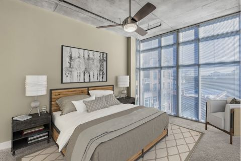 Bedroom with Floor-To-Ceiling Windows at Camden Cotton Mills Apartments in Charlotte, NC