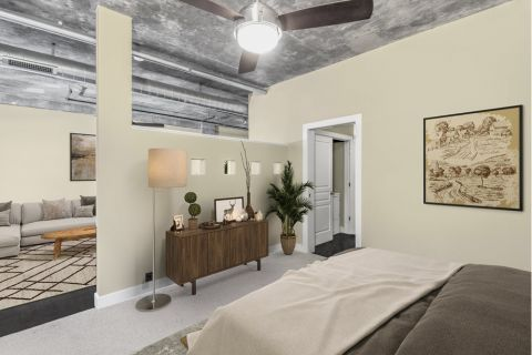 Bedroom with Full-Size Washer and Dryer at Camden Cotton Mills Apartments in Charlotte, NC