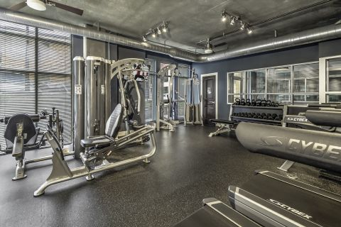 Fitness Center with Cardio Equipment and Free Weights at Camden Cotton Mills in Charlotte, NC