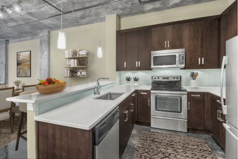 Kitchen and Dining Space in Open-Concept Floor Plan at Camden Cotton Mills Apartments in Charlotte, NC