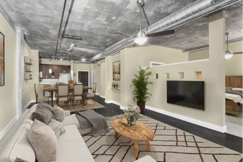 Living and Dining Space in One Bedroom Open-Concept Floor Plan at Camden Cotton Mills Apartments in Charlotte, NC