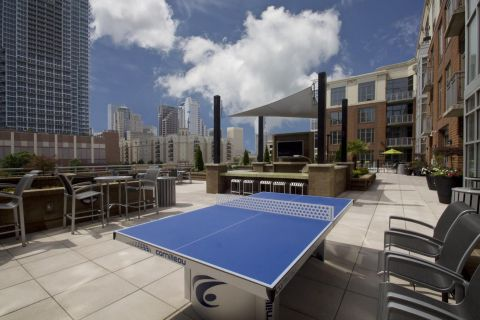 Outdoor Game Room at Camden Cotton Mills Apartments in Charlotte, NC