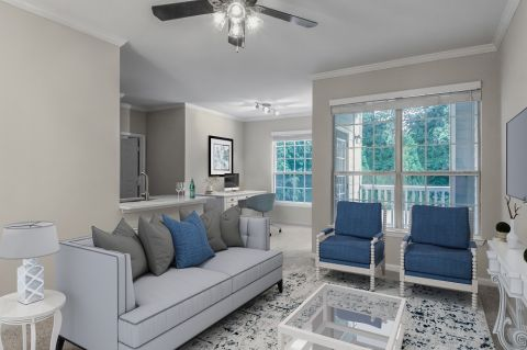 Living Room with home office space at Camden Creekstone Apartments in Atlanta, GA