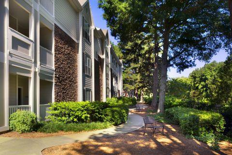 Walking Path and Exterior of Buildings at Camden Creekstone Apartments in Atlanta, GA