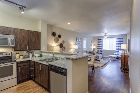 Kitchen and Living Room at Camden Crown Valley Apartments in Mission Viejo, CA