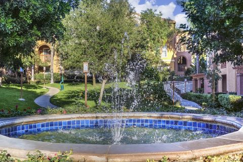 Green walkways with water fountain at Camden Crown Valley Apartments in Mission Viejo, CA